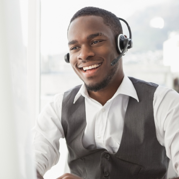 man providing customer service at computer 600